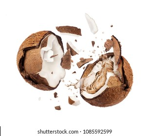 Coconut broken in the air into two halves