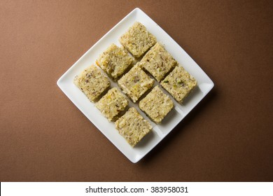Coconut burfi - indian popular sweet made up of coconut, milk and sugar