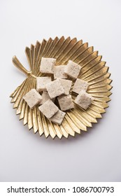 Coconut burfi or Nariyal Barfi is a sweet cake served in a plate selective focus