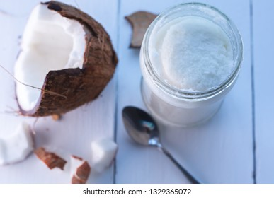 coconut butter on white wooden background
