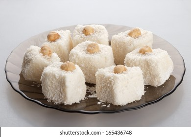coconut cakes on a brown glass plate