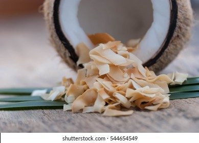 coconut chips on wooden background.