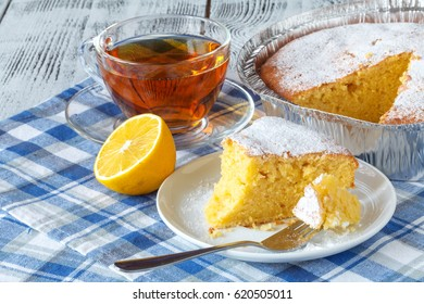 Coconut citrus syrup cake served on plate