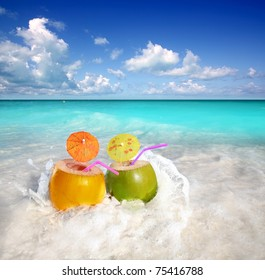 coconut cocktails juice in tropical beach water splash turquoise caribbean