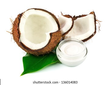 Coconut cocos with cream and green leaf isolated on white background