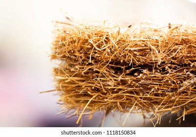 Coconut coir. Grated coconut shell for the production of mattresses. texture, natural background. Coconut coir pressed at the factory. Background of coconut fiber.