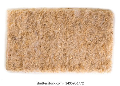 Coconut coir on a white background. Grated coconut shell for the production of mattresses. texture, natural background. Coconut coir pressed at the factory. Background of coconut fiber.