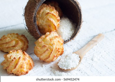 Coconut cookies macarons with copra on a white background closeup