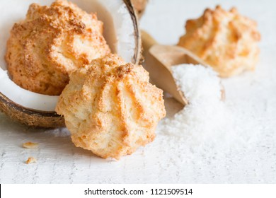 Coconut cookies on white background with fresh copra