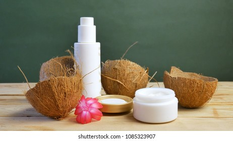 Coconut cosmetic cream and exotic tropic flowers and leaves. Natural cosmetic concept