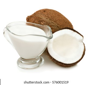 Coconut cream, milk, coconuts isolated on a white background closeup