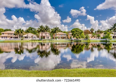 COCONUT CREEK, FL, USA: View of a lake and surrounding homes.