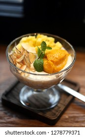 Coconut dessert with mango and chips is very tasty