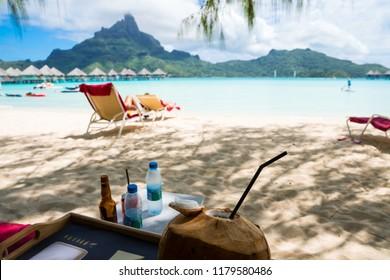 Coconut drink on Bora Bora beach