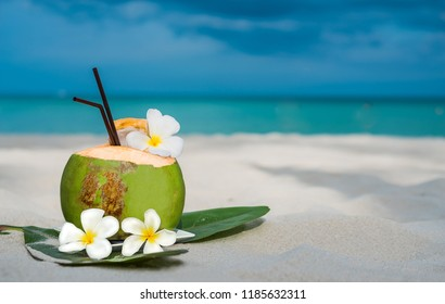Coconut drink on the calm beach clear water and blue sky the famous beach on Koh Samui Surat Thani Thailand