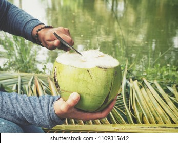 Coconut drink on hand