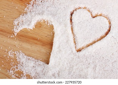 coconut flakes scattered in the form of two hearts