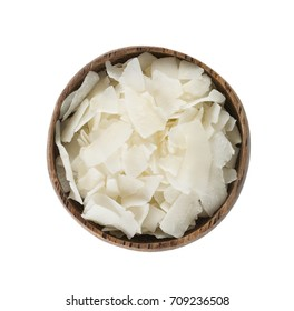 coconut flakes in a wooden bowl isolated on white