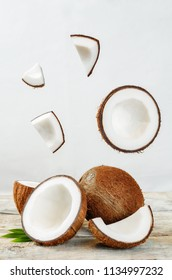 Coconut with flying slices on a white background. toning. selective focus