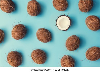 Coconut fruit colorful pattern on a pastel blue background. Summer concept. Flat lay.