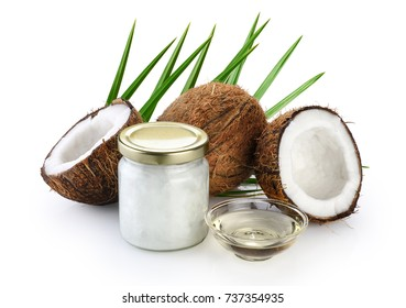 Coconut and glass jar with fresh coconut oil isolated on white background. Palm leaf.
