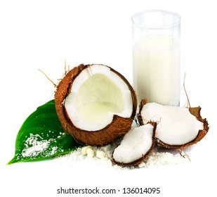 Coconut with glass of coconut milk and green leaf isolated on white background