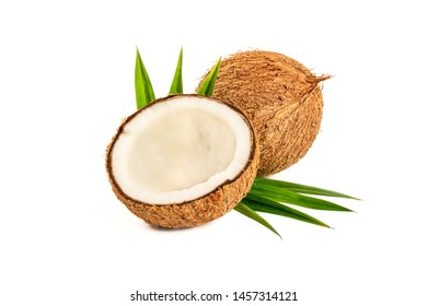Coconut with half and leaves isolated on white background.