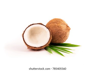 Coconut with half and leaves isolated on white backgeound.