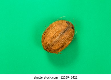 Coconut isolated on green background