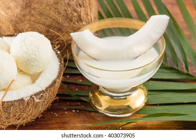 Coconut liqueur in glass served with fresh coconut