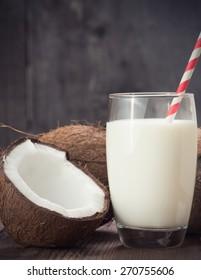 Coconut Milk in a glass on dark wooden background
