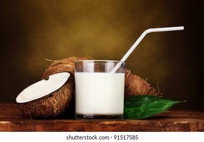 Coconut milk and coconut on brown