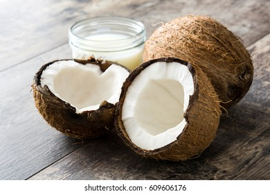 Coconut and coconut milk on wooden table