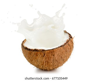 coconut milk spilling out of an half fruit