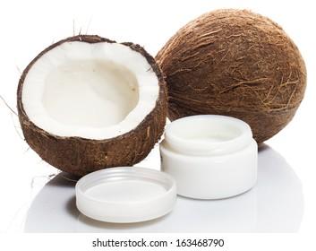 Coconut and moisturizer cream on white background