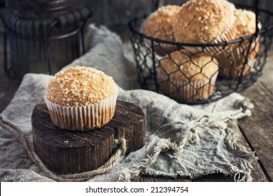 coconut muffins on a rustic background, toning