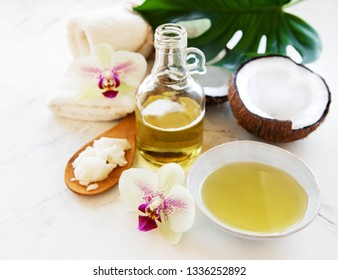 Coconut natural spa ingredients on a white marble background