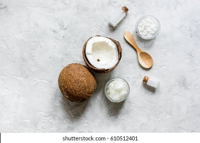 coconut oil for body care in cosmetic concept on stone desk