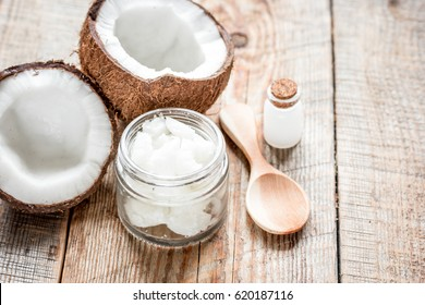 coconut oil for body care in cosmetic concept on old wooden table