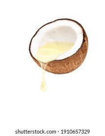 Coconut oil dripping from coconut fruits cut in half isolated on white background.