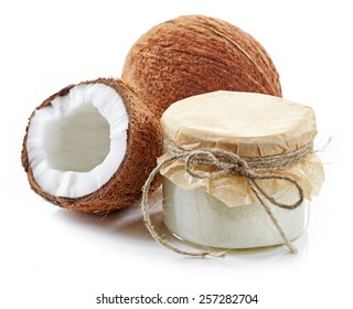 coconut oil and fresh coconuts isolated on white