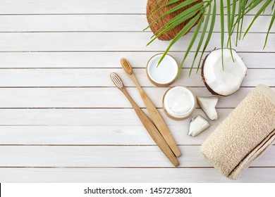 Coconut oil and mint homemade toothpaste, eco friendly bamboo toothbrush, natural healthcare.
