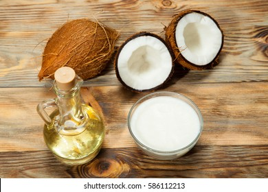 Coconut oil, coconut on a wooden background