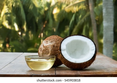 coconut and coconut oil with coconut tree background.