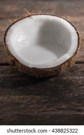 Coconut on a wood background.coconut milk