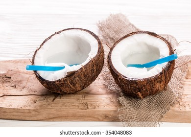 Coconut on wooden table.Organic healthy food concept.Beauty and SPA concept.
