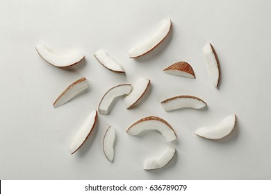 Coconut pieces on white background
