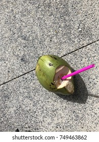 Coconut with pink straw
