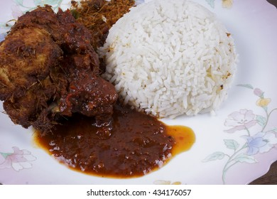 "Coconut Rice (""Nasi Lemak"")-Malaysian cuisine. A fragrant rice dish cooked in coconut milk and pandan leaf commonly found in Malaysia. Served with chicken and chili paste. Selective focus"