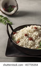 Coconut Rice, specialty of Kerala topped with roasted groundnut.
